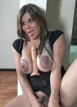 Check out the Huge Tattooed Tits on this Slut