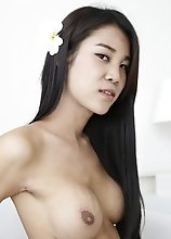 21yo busty Thai shemale strips and grabs a big white cock to suck